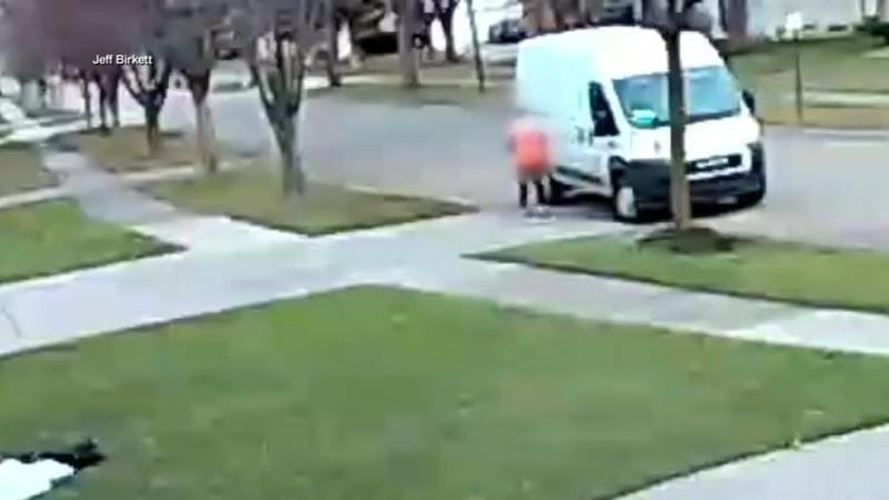 Delivery Driver Caught On Camera Running Over Package Repeatedly
