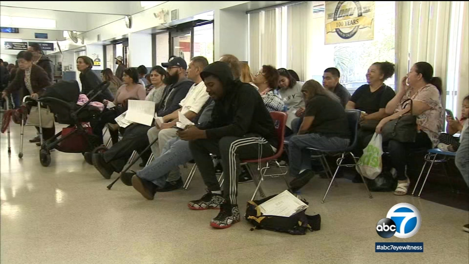 People across California standing in line at Department of Motor Vehicles to get Real ID