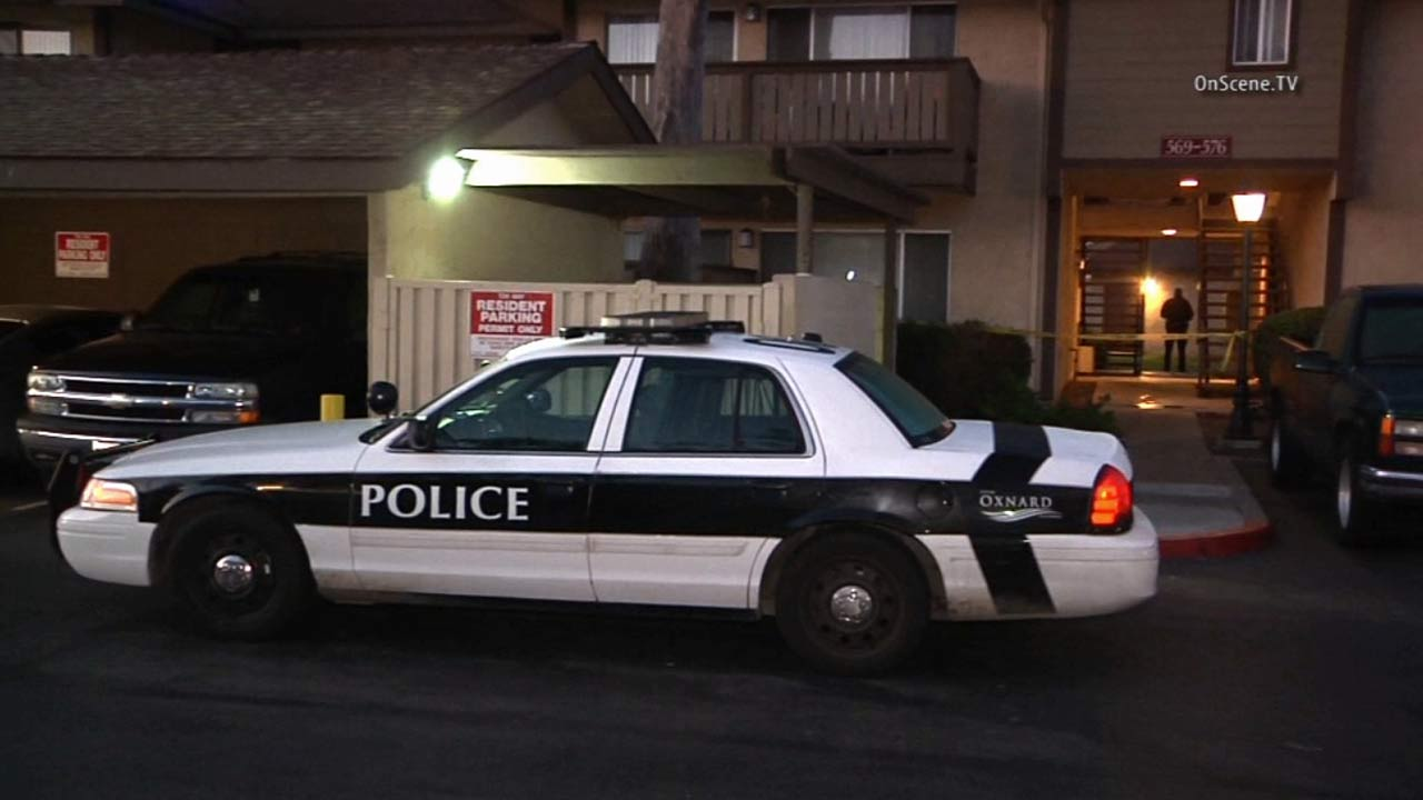 An Oxnard Police Department squad car sits in front of an apartment complex where a woman was killed in an officer-involved shooting on Saturday, March 28, 2015.