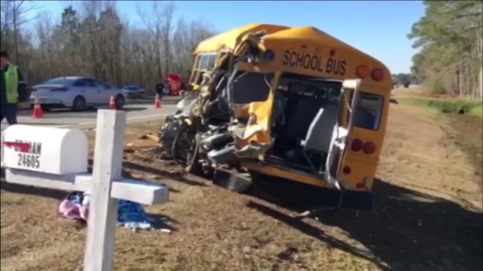 Tractor-trailer crashes into school bus, causing it to flip 3 times in eastern North Carolina 1