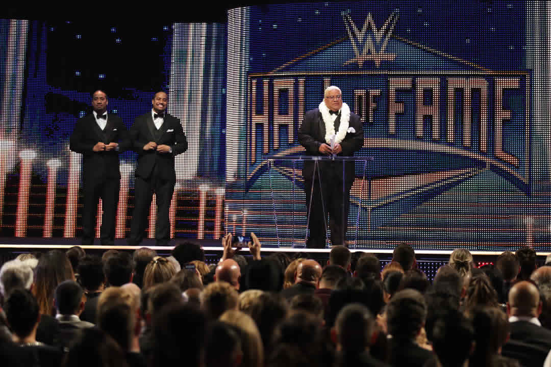 "<div class=""meta image-caption""><div class=""origin-logo origin-image none""><span>none</span></div><span class=""caption-text"">Inductee Rikishi accepts his award with his sons, Jimmy and Jey Uso at the WWE Hall of Fame Ceremony, on Saturday, March 28, 2015 in San Jose, Calif. (Don Feria/AP Images for WWE)</span></div>"