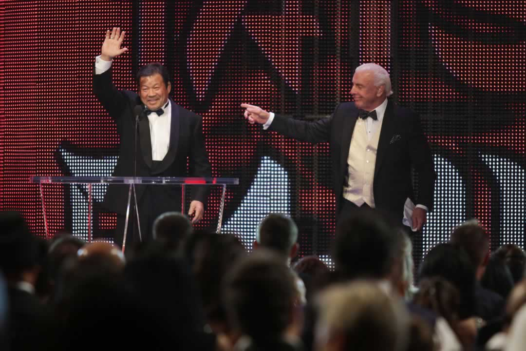 "<div class=""meta image-caption""><div class=""origin-logo origin-image none""><span>none</span></div><span class=""caption-text"">Inductee Tatsumi Fujinami, left, is introduced by Ric Flair at the WWE Hall of Fame Ceremony, on Saturday, March 28, 2015 in San Jose, Calif. (Don Feria/AP Images for WWE)</span></div>"
