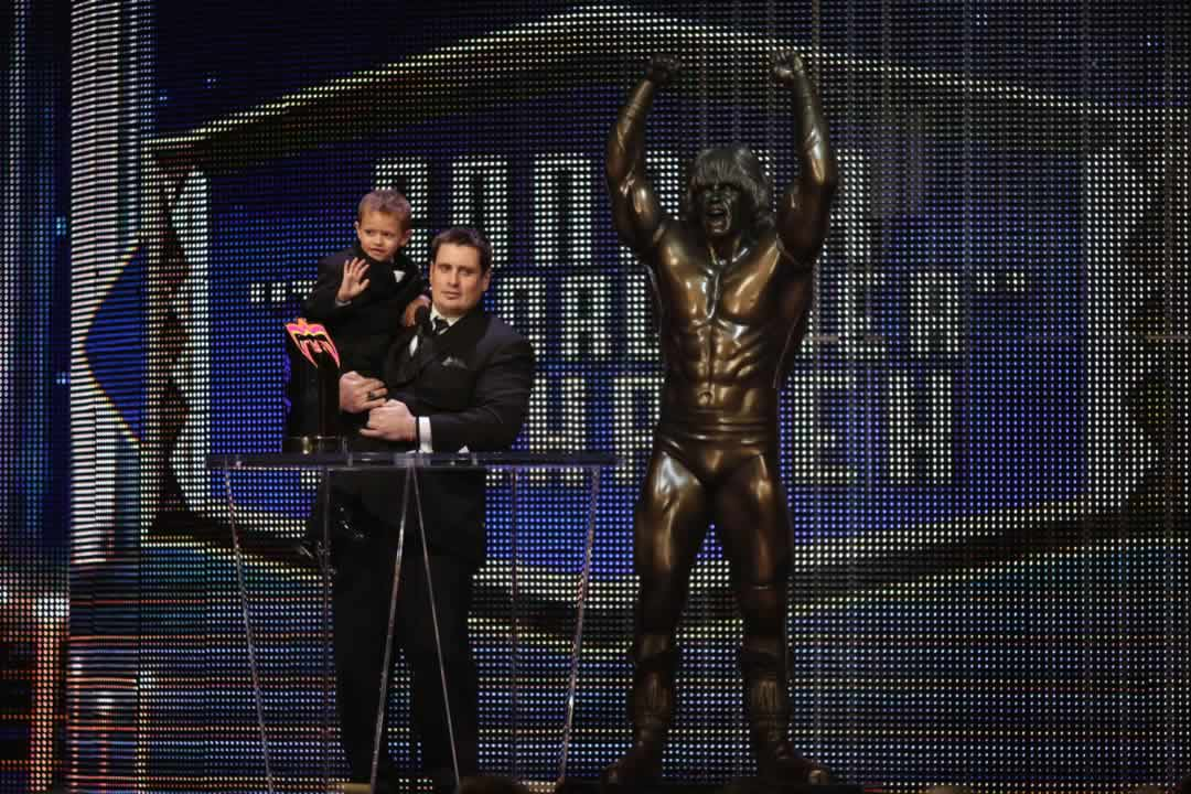 "<div class=""meta image-caption""><div class=""origin-logo origin-image none""><span>none</span></div><span class=""caption-text"">The dad of the late Connor ""The Crusher"" Michalek holds his son Jackson, as he accepts an award in honor of Connor at the WWE Hall of Fame on March 28, 2015 in San Jose, Calif. (Don Feria/AP Images for WWE)</span></div>"