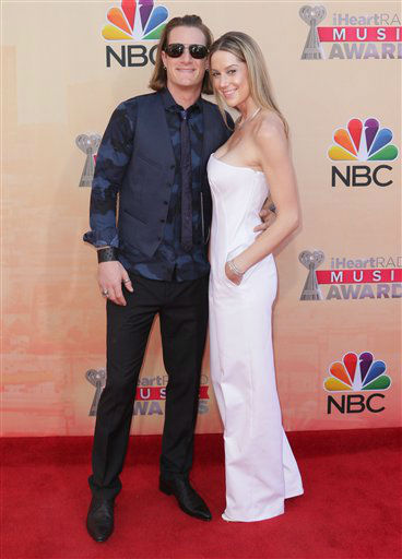 "<div class=""meta image-caption""><div class=""origin-logo origin-image none""><span>none</span></div><span class=""caption-text"">Tyler Hubbard, of Florida Georgia Line, left, and Hayley Stommel arrive at the iHeartRadio Music Awards at The Shrine Auditorium on Sunday, March 29, 2015 (AP)</span></div>"