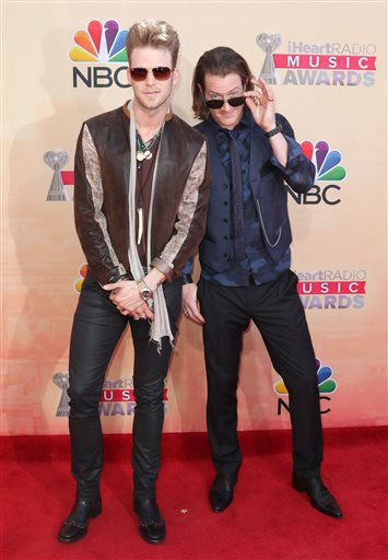 "<div class=""meta image-caption""><div class=""origin-logo origin-image none""><span>none</span></div><span class=""caption-text"">Brian Kelley, left, and Tyler Hubbard, of Florida Georgia Line, arrive at the iHeartRadio Music Awards (Photo/John Salangsang)</span></div>"