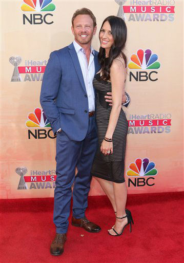 "<div class=""meta image-caption""><div class=""origin-logo origin-image none""><span>none</span></div><span class=""caption-text"">Ian Ziering, left, and Erin Kristine Ludwig arrive at the iHeartRadio Music Awards at The Shrine Auditorium on Sunday, March 29, 2015 (AP)</span></div>"