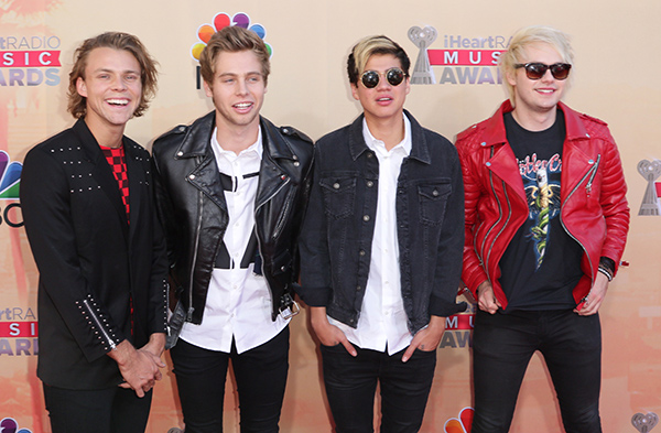 """<div class=""""meta image-caption""""><div class=""""origin-logo origin-image none""""><span>none</span></div><span class=""""caption-text"""">Ashton Irwin, from left, Calum Hood, Luke Hemmings and Michael Clifford of 5 Seconds of Summer arrives at the iHeartRadio Music Awards at The Shrine Auditorium on March 29, 2015. (John Salangsang/Invision/AP)</span></div>"""