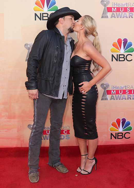 """<div class=""""meta image-caption""""><div class=""""origin-logo origin-image none""""><span>none</span></div><span class=""""caption-text"""">Jason Aldean, left, and new wife Brittany Kerr arrive at the iHeartRadio Music Awards at The Shrine Auditorium on Sunday, March 29, 2015, in Los Angeles. (John Salangsang/Invision/AP)</span></div>"""