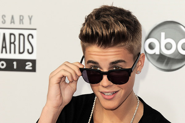 "<div class=""meta image-caption""><div class=""origin-logo origin-image ap""><span>AP</span></div><span class=""caption-text"">In this Nov. 18, 2012 file photo, Justin Bieber arrives at the 40th Anniversary American Music Awards in Los Angeles.</span></div>"