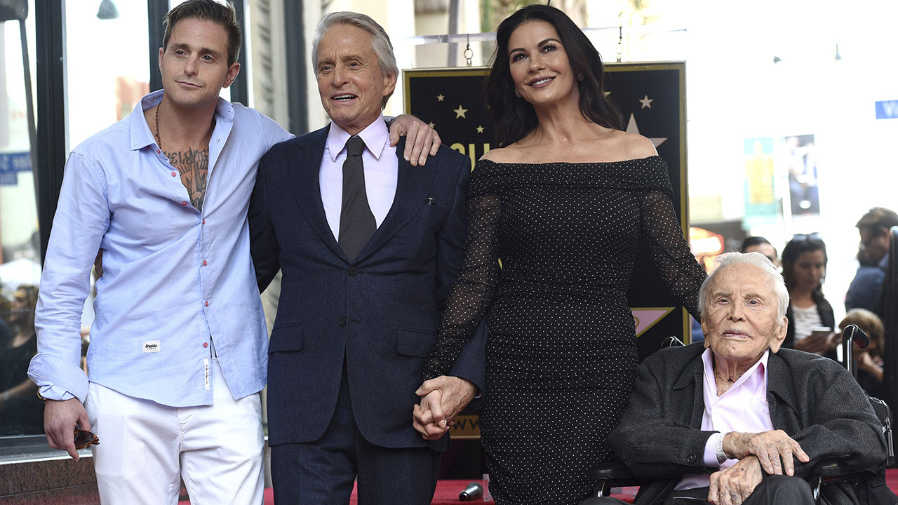 Kirk Douglas appears at a Hollywood Walk of Fame star ceremony for his son Michael on Nov. 6, 2018, with Michael's son Cameron (far left) and Michael's wife Catherine Zeta-Jones.