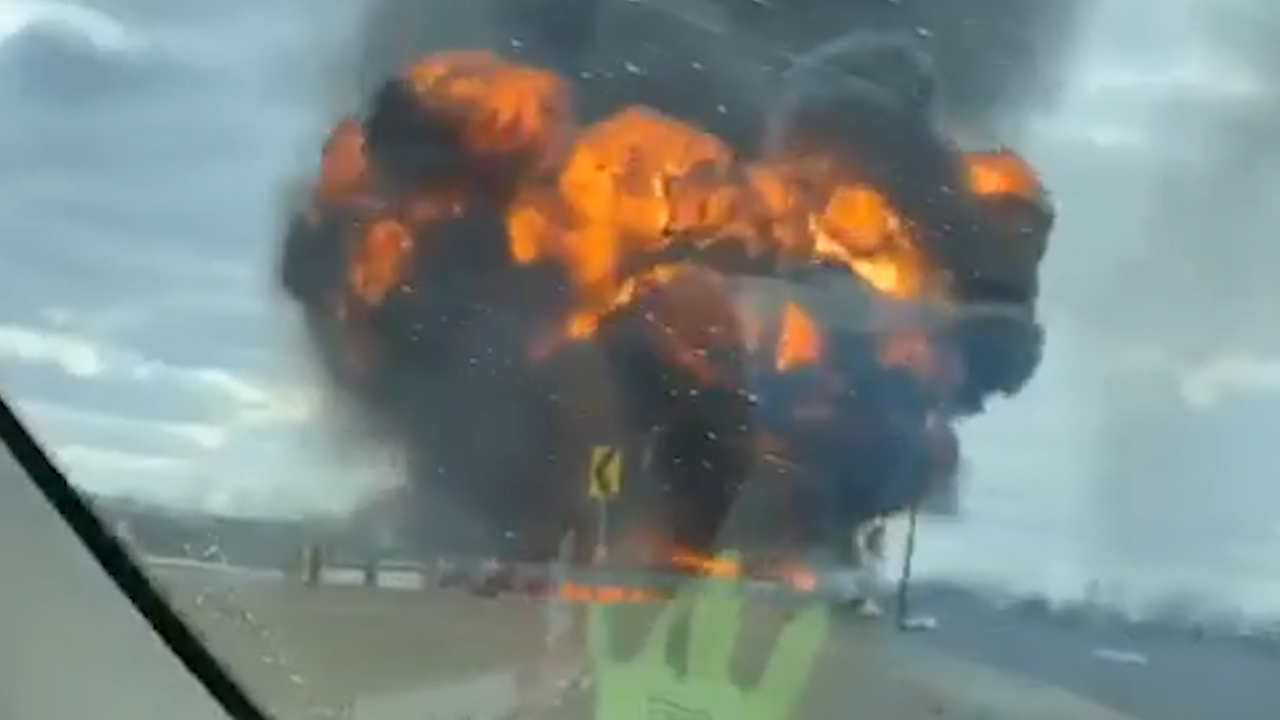 VIDEO: Huge fire burns near Indiana highway after semitrailer hauling fuel rolls over on ramp