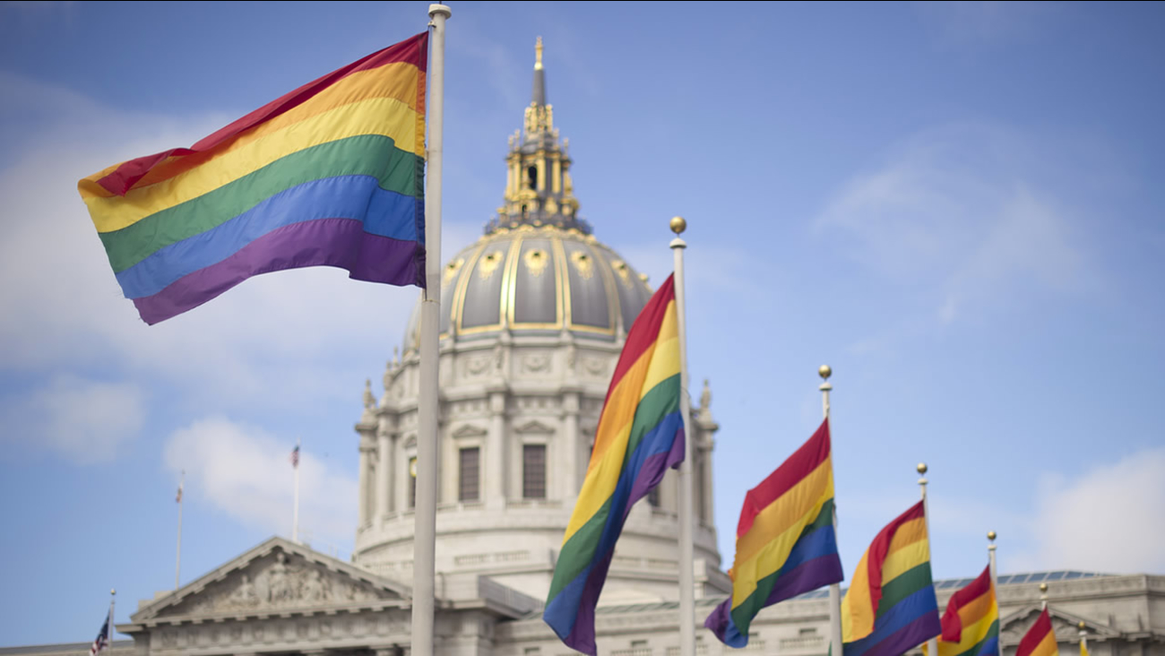 Rainbow flags fly in front of San Francisco City Hall on June 26, 2013, shortly after the U.S. Supreme Court decision that cleared the way for same-sex marriage in California. (AP Photo/Noah Berger)