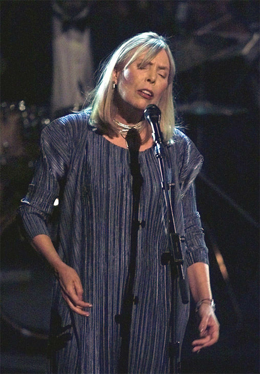 """<div class=""""meta image-caption""""><div class=""""origin-logo origin-image none""""><span>none</span></div><span class=""""caption-text"""">April 2000: Joni Mitchell sings her song """"Both Sides Now,"""" during Turner Network Television's All-Star Tribute to Joni Mitchell. (AP)</span></div>"""