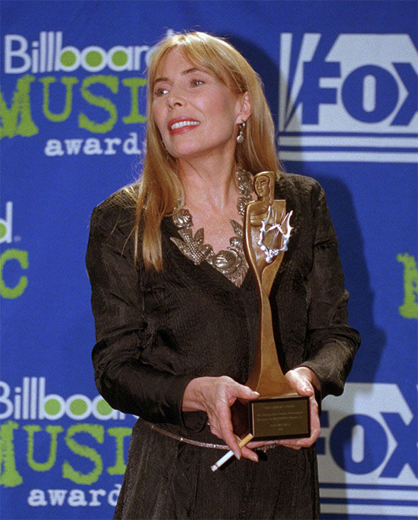 """<div class=""""meta image-caption""""><div class=""""origin-logo origin-image none""""><span>none</span></div><span class=""""caption-text"""">Dec. 1995: Mitchell poses with the Century Award at the 1995 Billboard Music Awards in NY. Mitchell was honored for her years of accomplishments in the music business. (AP)</span></div>"""