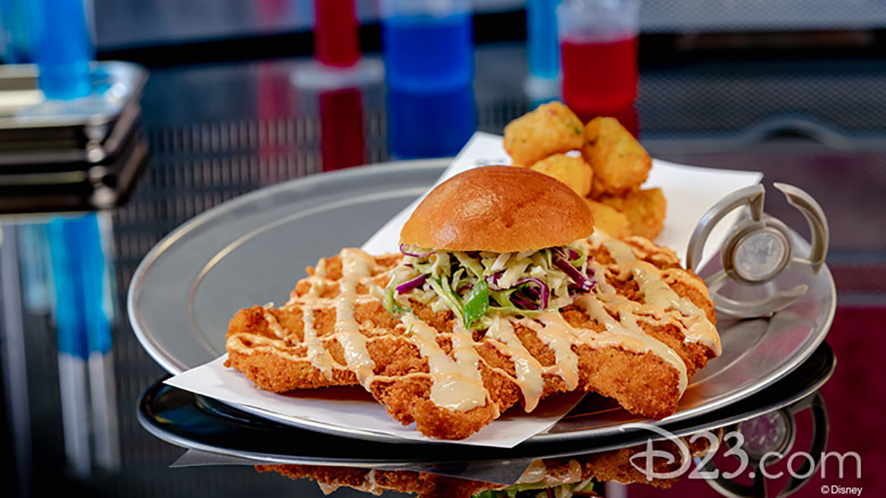 Innovative food, like the massive crispy breaded chicken breast sandwich, awaits guests at the Pym Test Kitchen.