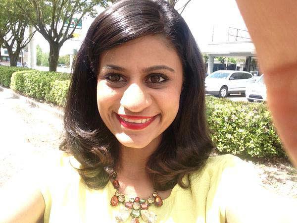 "<div class=""meta image-caption""><div class=""origin-logo origin-image none""><span>none</span></div><span class=""caption-text"">Pooja Lodhia with her red lip selfie (KTRK Photo)</span></div>"
