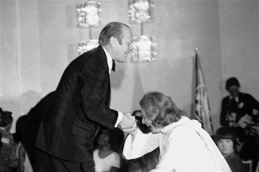 """<div class=""""meta image-caption""""><div class=""""origin-logo origin-image """"><span></span></div><span class=""""caption-text"""">President Gerald Ford gives television personality Barbara Walters a helping hand as she slips while stepping onto the stage during an awards presentation March 10, 1975. (AP Photo/ Anonymous)</span></div>"""