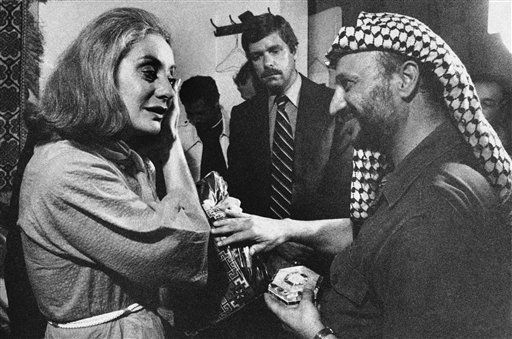 """<div class=""""meta image-caption""""><div class=""""origin-logo origin-image """"><span></span></div><span class=""""caption-text"""">Palestinian leader Yasir Arafat presents Barbara Walters of ABC with a handmade dress and mother- of-pearl box following an interview with him in Beirut, Sept. 21 1977. (AP Photo/Harry Koundakjian)</span></div>"""