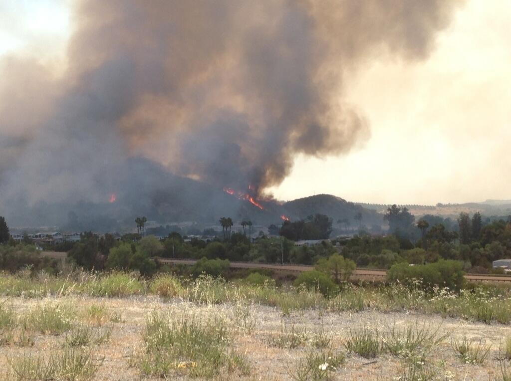 "<div class=""meta image-caption""><div class=""origin-logo origin-image ""><span></span></div><span class=""caption-text"">Inland Empire Bureau Chief Rob McMillan took this photo of flames climbing hills above homes near Camp Pendleton area, Wednesday, May 14, 2014. (Rob McMillan)</span></div>"