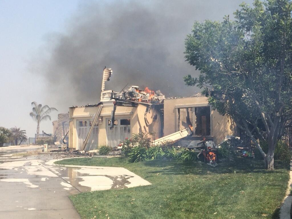 """<div class=""""meta image-caption""""><div class=""""origin-logo origin-image """"><span></span></div><span class=""""caption-text"""">One of at least 30 homes destroyed by fire in Carlsbad, Wednesday, May 14, 2014. Photo: Inland Empire Bureau Chief Rob McMillan (Rob McMillan)</span></div>"""