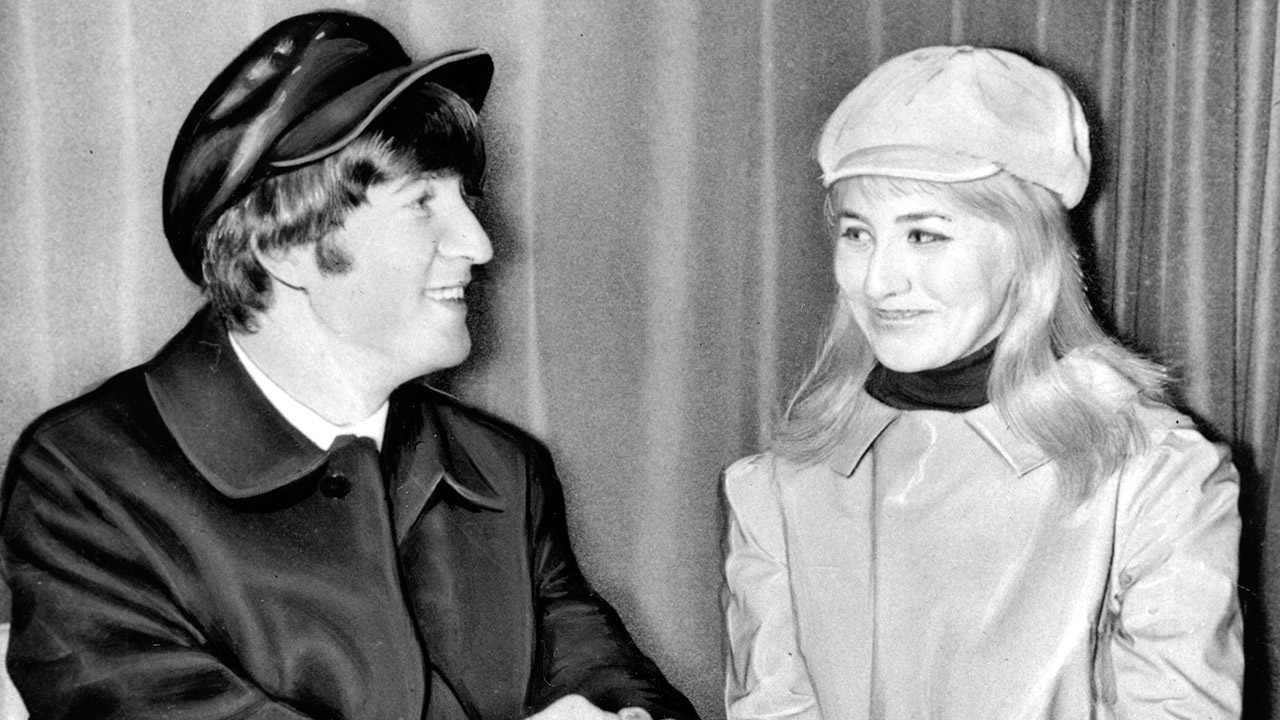 Beatles great John Lennon and his former wife, Cynthia, sit in London Airport, England, before flying to the U.S. on Feb. 7, 1964.