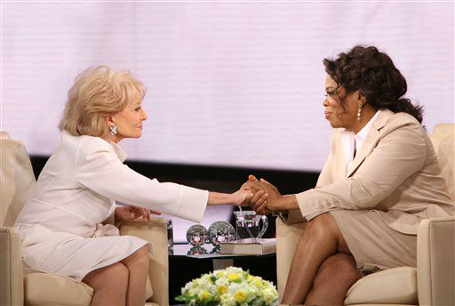 """<div class=""""meta image-caption""""><div class=""""origin-logo origin-image """"><span></span></div><span class=""""caption-text"""">In this image released by Harpo Productions, journalist Barbara Walters, left, holds the hand of Oprah Winfrey during an interview for """"The Oprah Winfrey Show,"""" in April 2008. (AP Photo/George Burns)</span></div>"""