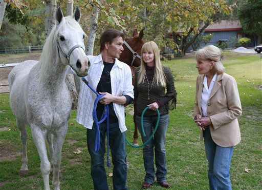 """<div class=""""meta image-caption""""><div class=""""origin-logo origin-image """"><span></span></div><span class=""""caption-text"""">In this image released by ABC, Barbara Walters, right, visits with actor Patrick Swayze, left, and his wife Lisa Niemi at their California ranch on Dec. 6, 2008. (AP Photo/ RON TOM)</span></div>"""