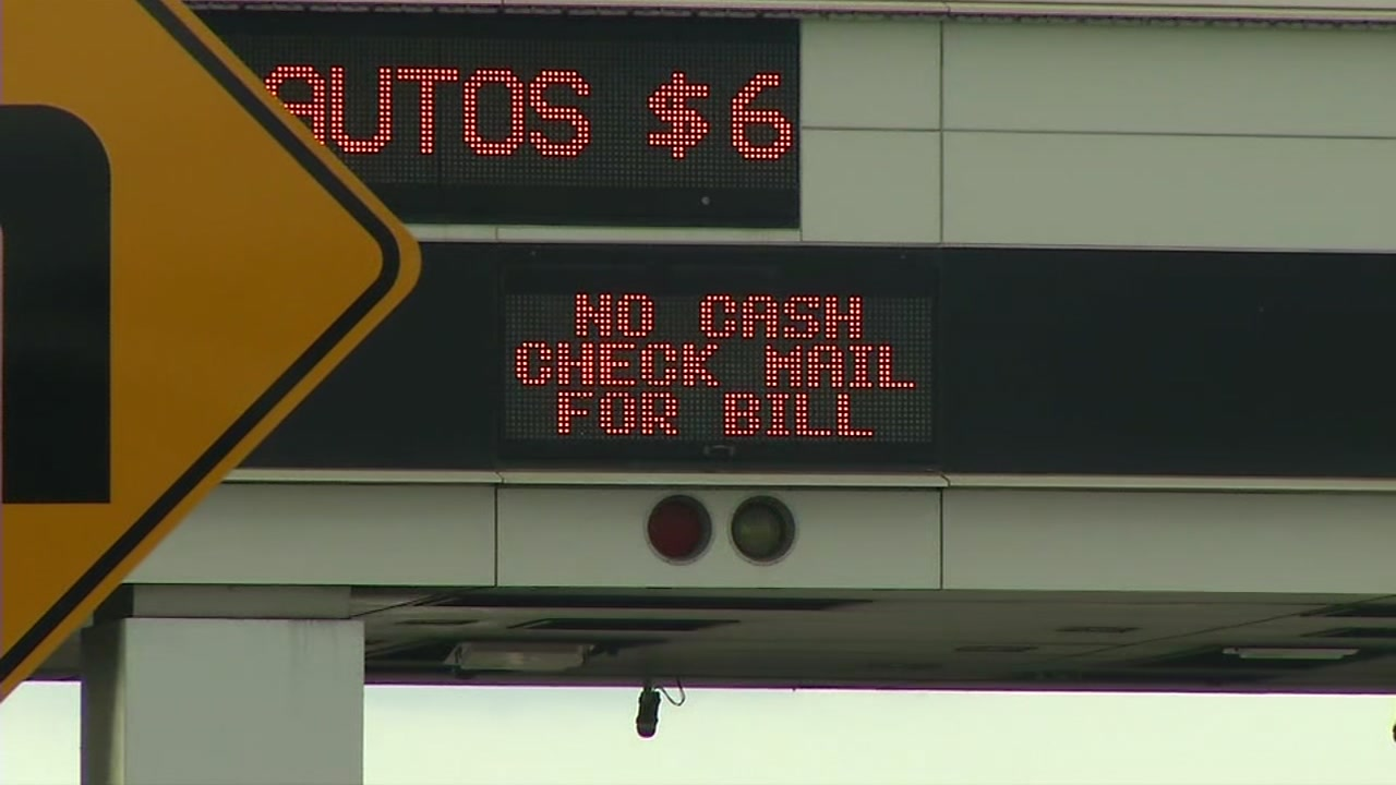 "This Saturday, March 21, 2020 image shows a sign at the Bay Bridge toll plaza in San Francisco that says ""No cash. Check mail for bills."""