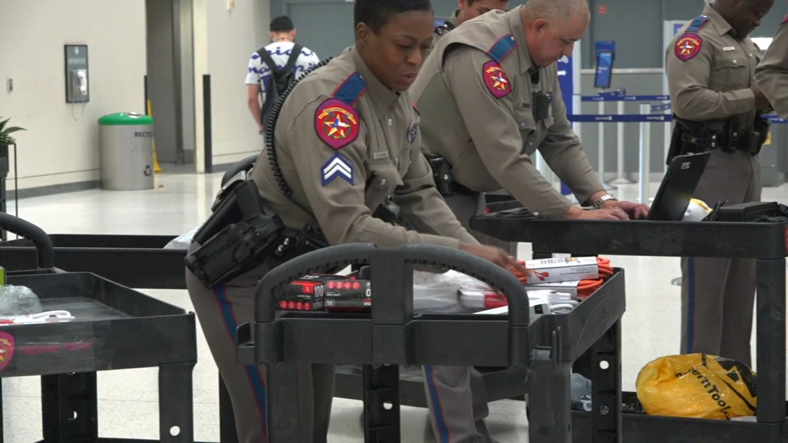 Texas DPS troopers screen passengers at Bush Intercontinental and ...