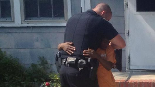 Cameron Simmons and Officer Gaetano Acerra share a hug.