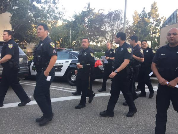 "<div class=""meta image-caption""><div class=""origin-logo origin-image kgo""><span>KGO</span></div><span class=""caption-text"">Officers and deputies arrive to assist SJPD on Thursday, April 2, 2015. (KGO-TV/Janet O)</span></div>"