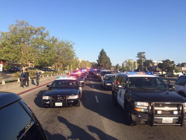 "<div class=""meta image-caption""><div class=""origin-logo origin-image kgo""><span>KGO</span></div><span class=""caption-text"">Patrol vehicles prepare for the start of the memorial procession for SJPD Officer Michael Johnson on Thursday, April 2, 2015. (KGO-TV/Matt Keller)</span></div>"