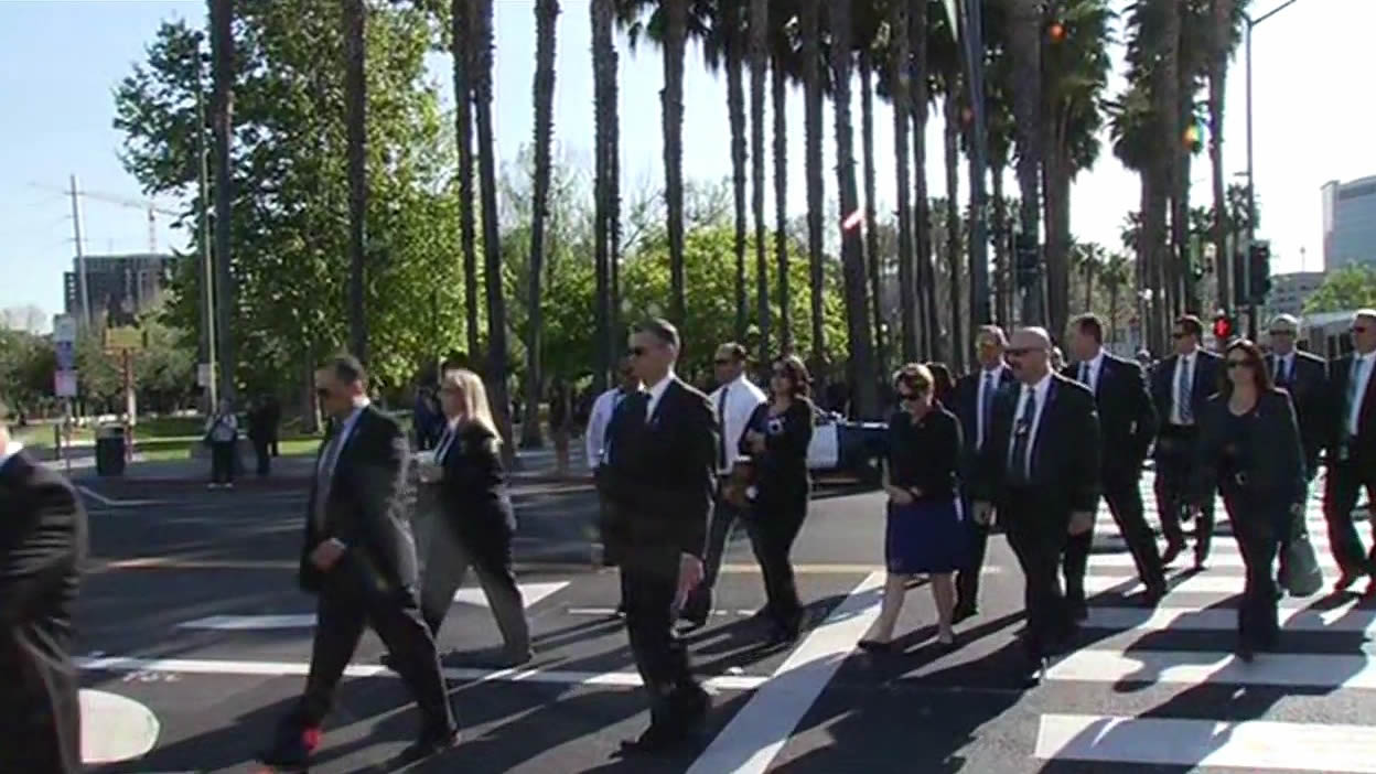"<div class=""meta image-caption""><div class=""origin-logo origin-image kgo""><span>KGO</span></div><span class=""caption-text"">Guests arrive at the SAP Center for the memorial service for SJPD Officer Michael Johnson on Thursday, April 2, 2015. (KGO-TV) (Guests arrive)</span></div>"