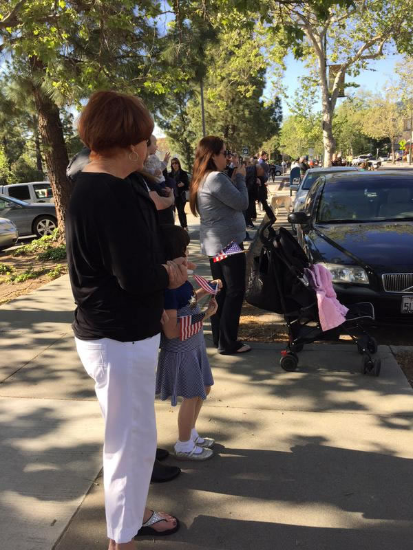 "<div class=""meta image-caption""><div class=""origin-logo origin-image kgo""><span>KGO</span></div><span class=""caption-text"">Families await the start of the funeral procession for SJPD Officer Michael Johnson on Thursday, April 2, 2015. (KGO-TV)</span></div>"