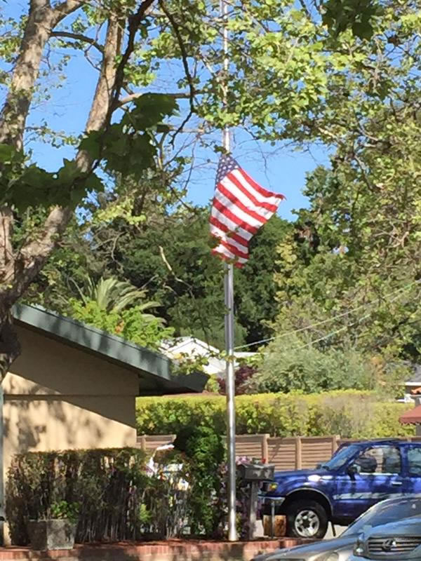 "<div class=""meta image-caption""><div class=""origin-logo origin-image kgo""><span>KGO</span></div><span class=""caption-text"">The flag flying at half staff outside the Darling Fischer Funeral Home in Los Gatos where Officer Johnson's procession began on Thursday, April 2, 2015. (KGO-TV)</span></div>"