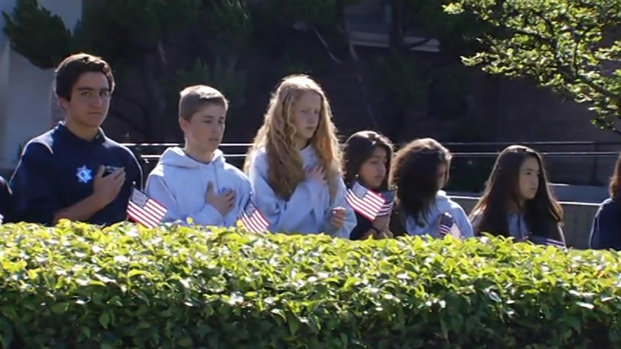 "<div class=""meta image-caption""><div class=""origin-logo origin-image kgo""><span>KGO</span></div><span class=""caption-text"">Students from St. Lucy Parish School in Campbell line the streets as the Hearst of SJPD Officer Michael Johnson passes by on Thursday, April 2, 2015. (KGO-TV)</span></div>"
