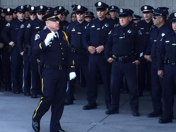 "<div class=""meta image-caption""><div class=""origin-logo origin-image kgo""><span>KGO</span></div><span class=""caption-text"">Officers with the San Jose police department attend the funeral service for Officer Michael Johnson at the SAP Center on Thursday, April 2, 2105. (KGO-TV)</span></div>"