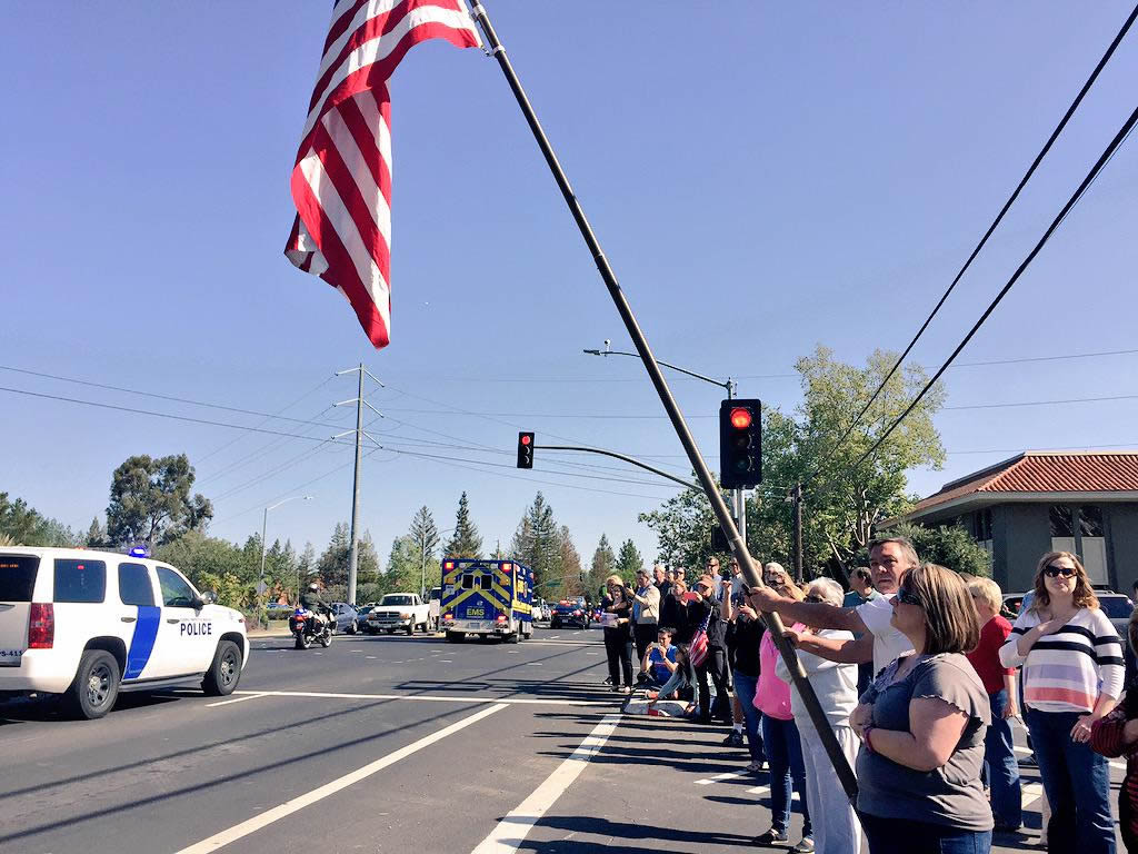 "<div class=""meta image-caption""><div class=""origin-logo origin-image kgo""><span>KGO</span></div><span class=""caption-text"">Scenes from the procession as it left Los Gatos en route to the SAP Center for the memorial service for SJPD officer Michael Johnson on Thursday, April 2, 2105. (KGO-TV)</span></div>"