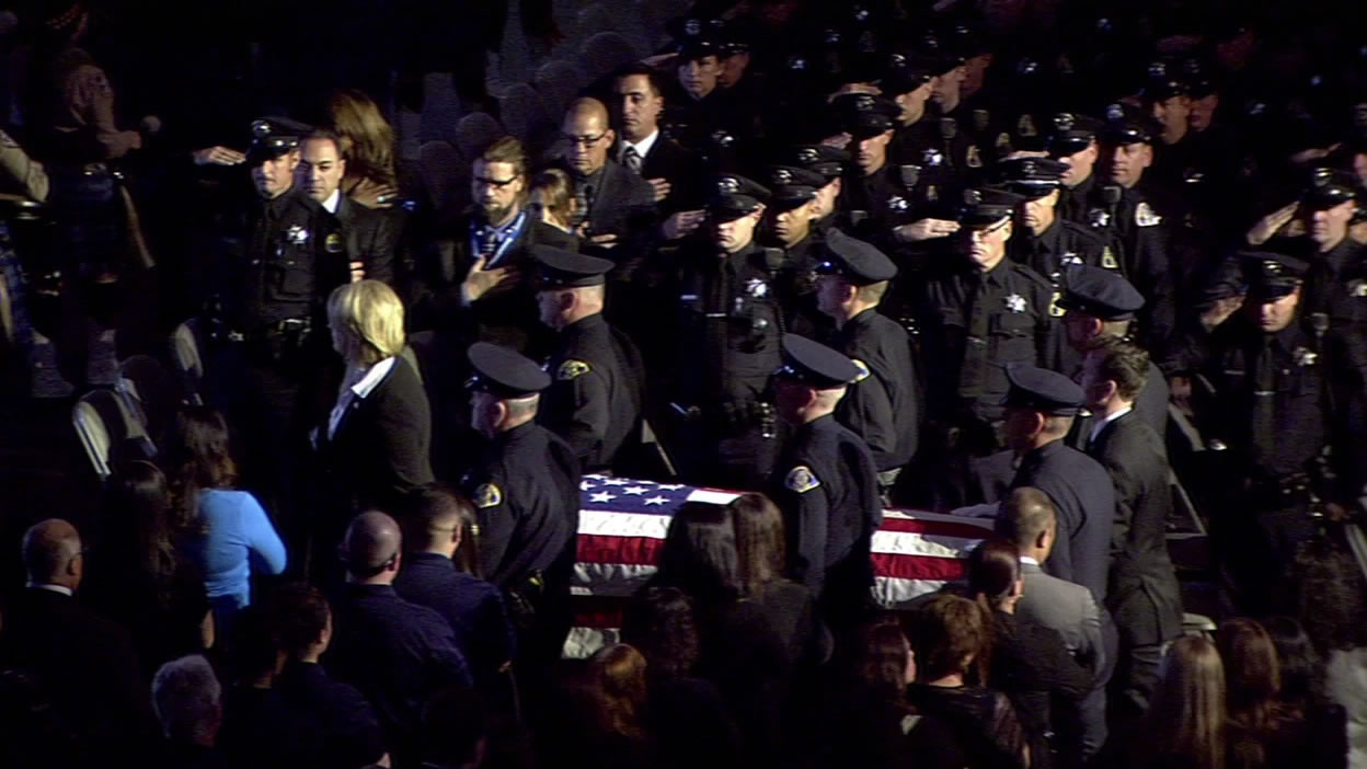 "<div class=""meta image-caption""><div class=""origin-logo origin-image kgo""><span>KGO</span></div><span class=""caption-text"">San Jose police officers lead the casket of Officer Michael Johnson out of the SAP Center after his memorial service on Thursday, April 2, 2105. (KGO-TV)</span></div>"