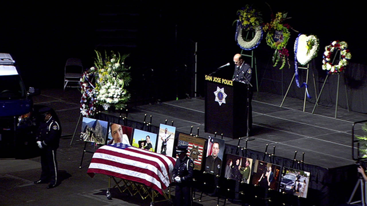 "<div class=""meta image-caption""><div class=""origin-logo origin-image kgo""><span>KGO</span></div><span class=""caption-text"">Final prayers for Officer Michael Johnson at the SAP Center on Thursday, April 2, 2015. (KGO-TV)</span></div>"