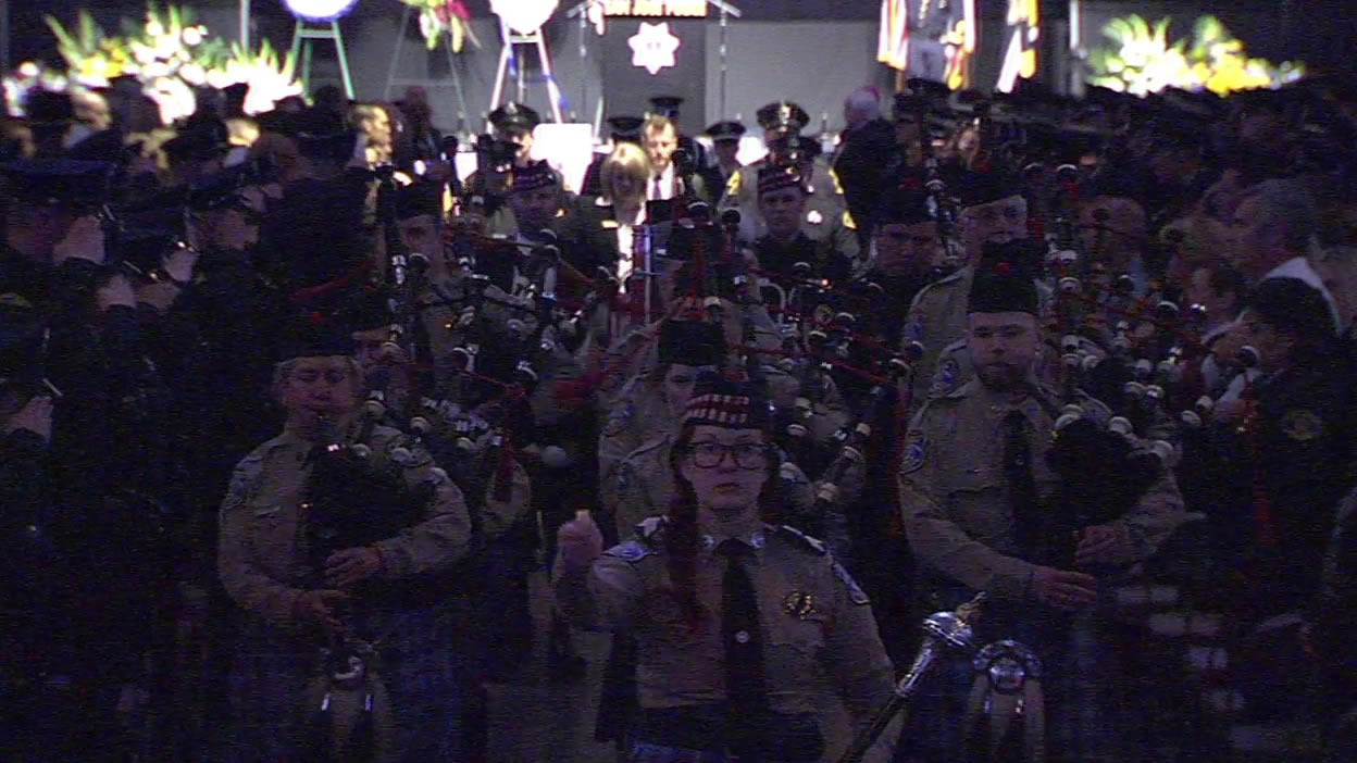 "<div class=""meta image-caption""><div class=""origin-logo origin-image none""><span>none</span></div><span class=""caption-text"">Bagpipe players lead the casket of Officer Michael Johnson out of the SAP Center after his memorial service on Thursday, April 2, 2105. (KGO-TV)</span></div>"