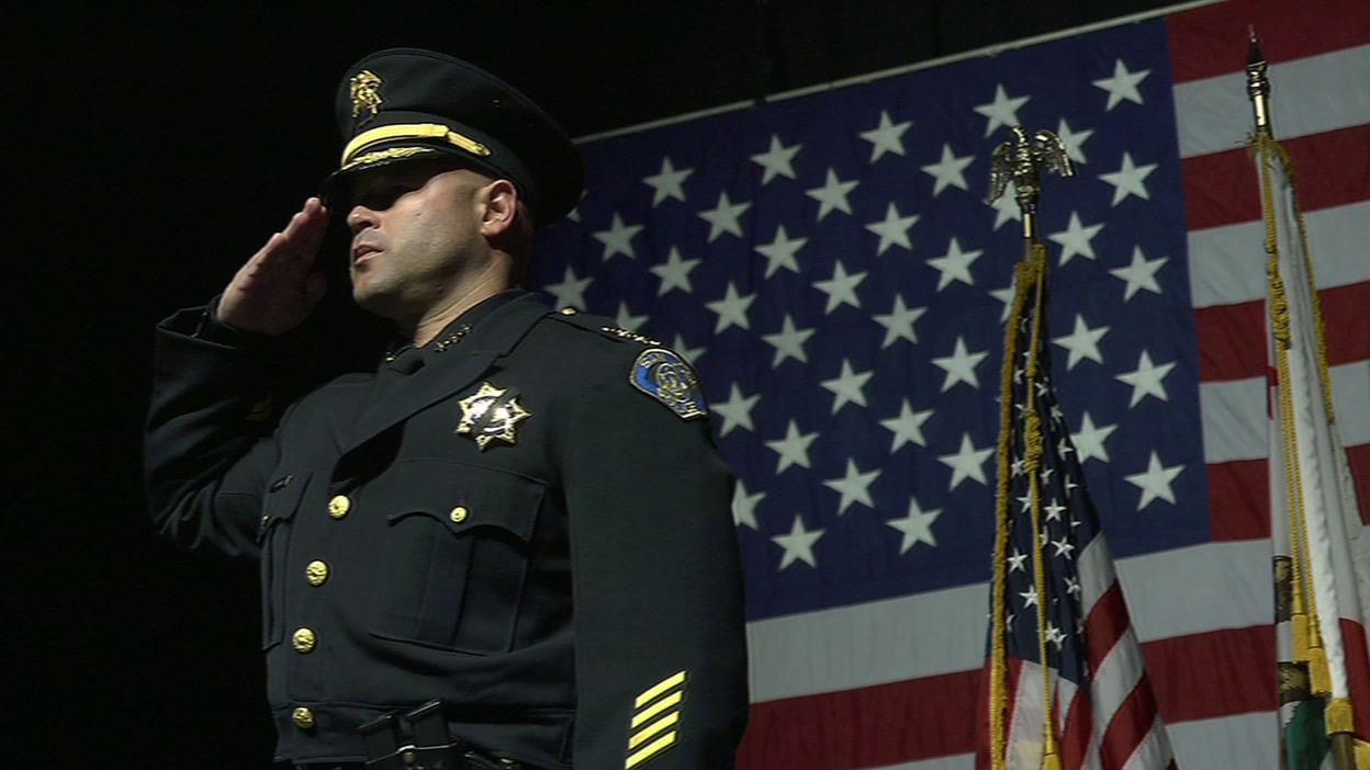 "<div class=""meta image-caption""><div class=""origin-logo origin-image kgo""><span>KGO</span></div><span class=""caption-text"">A San Jose police officer salutes as the casket of Officer Michael Johnson is lead out of the SAP Center after his memorial service on Thursday, April 2, 2105. (KGO-TV)</span></div>"