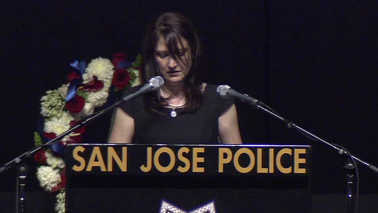 "<div class=""meta image-caption""><div class=""origin-logo origin-image kgo""><span>KGO</span></div><span class=""caption-text"">Jamie Radack remembers her brother, Officer Michael Johnson, at his memorial service on Thursday, April 2, 2105. (KGO-TV)</span></div>"