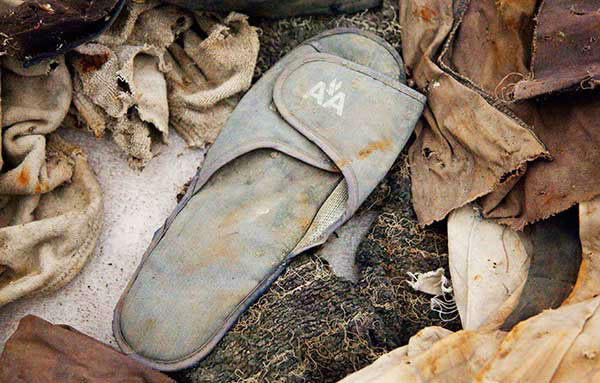 "<div class=""meta image-caption""><div class=""origin-logo origin-image ""><span></span></div><span class=""caption-text"">An American Airlines slipper, an artifact from the Sept. 11, 2001 attacks, will be part of the National September 11 Memorial Museum. (AP Photo/Mark Lennihan, File) (Photo/Mark Lennihan)</span></div>"