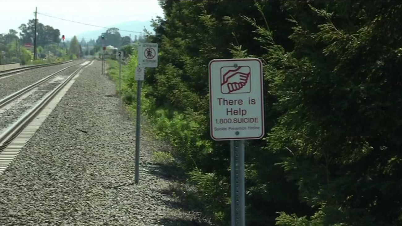 Caltrain has installed suicide hotline signs along its tracks.