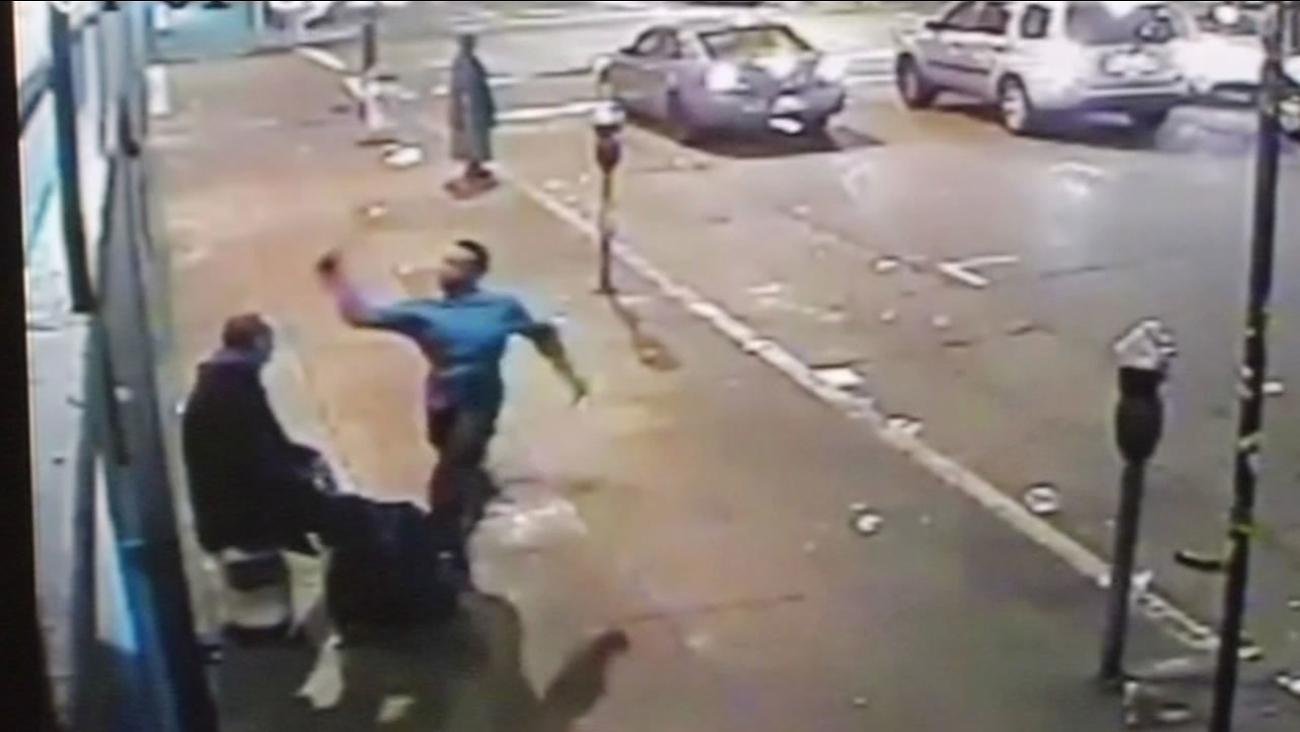 Surveillance video of man beaten by another man