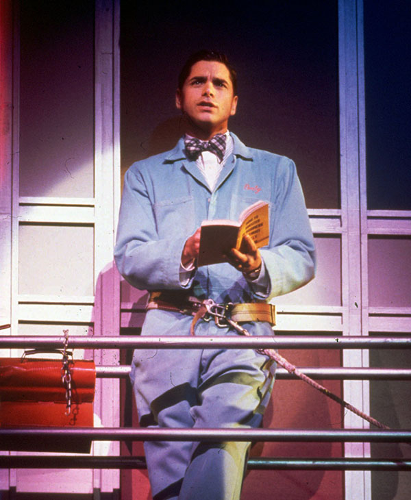 <div class='meta'><div class='origin-logo' data-origin='AP'></div><span class='caption-text' data-credit='AP'>THEN: John Stamos makes his entrance as an ambitious window washer in &#34;How To Succeed in Business Without Really Trying&#34; in 1995.</span></div>