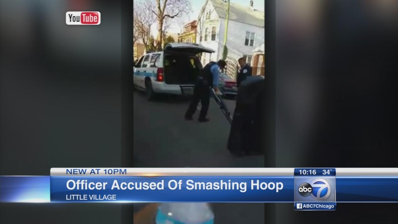Officer accused of breaking hoop