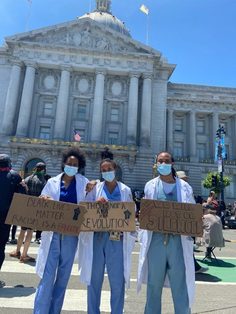 This June 4, 2020 image shows more health care workers at a protest for George Floyd in San Francisco.