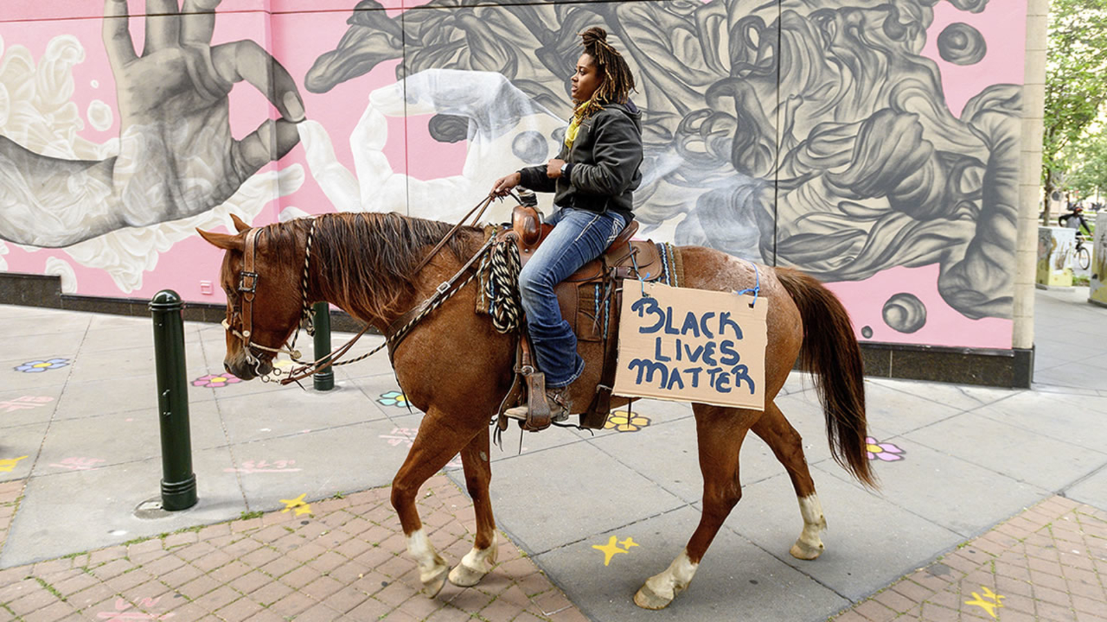 Meet the woman who protested in Oakland on a horse and learn why she did it